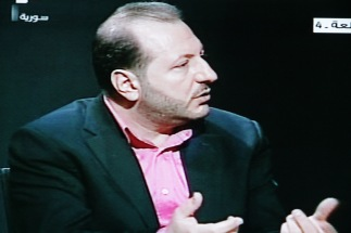 Interviewer on Syrian TV
